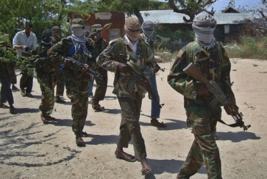 A file photo taken on March 5, 2012 shows Al-Qaeda linked al-Shebab recruits walking down a street in Mogadishu. A top leader of al-Shebab rebels has surrendered to government and African Union forces and is now in custody, officials said
